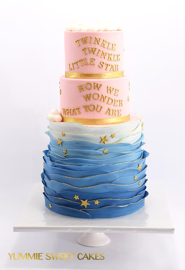 Gender reveal taart met goud tekst
