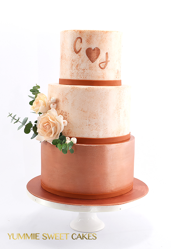Bruidstaart met rosé goud accenten