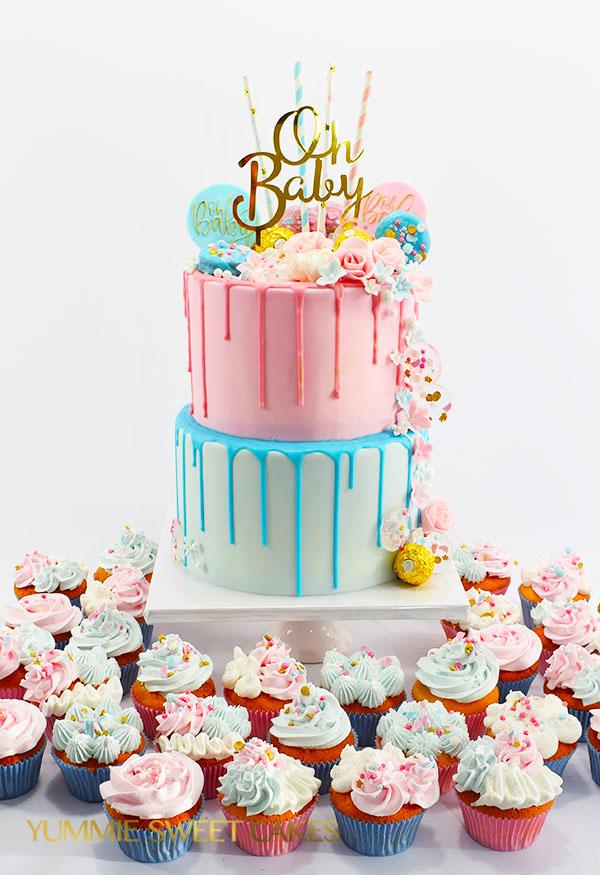 Een gender reveal taart met cupcakes