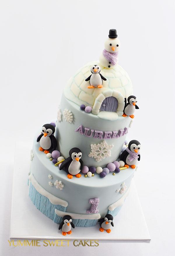 Een leuke taart met een iglo en pinguins